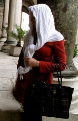 Respecting traditional local culture, although Istanbul is Westernized today and hijabs are not required.