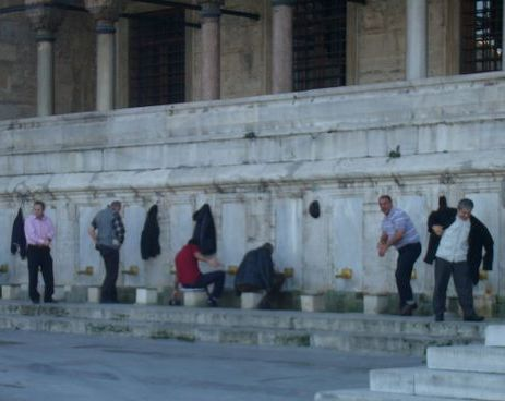 Turkish gentlemen wash their feet before prayer.