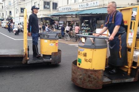 These fellas enjoyed driving Dad around the market on their mobile platforms.